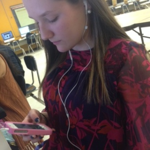 Chloe B. listening to Pandora via her iPhone