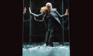 Tris must escape the glass box before drowning in water during one of her fear landscapes. Photo courtesy of divergentthemovie.com