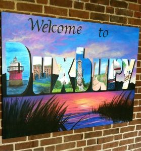"A painted ""Welcome to Duxbury"" sign in the DHS lobby"
