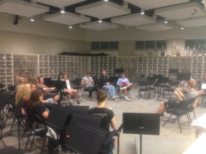 Students meet in the orchestra room for their play practice