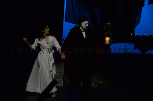 The Phantom and Christine traveling through the opera house.