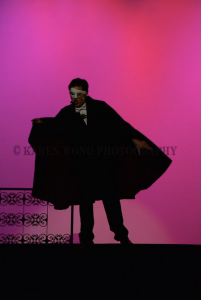 The Phantom threatens the owners of the opera house for disobeying him.