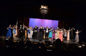 "The complete company of the musical, singing ""Masquerade."""