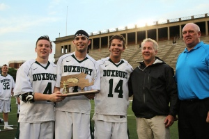 2014 Duxbury Lacrosse seniors Brendan Burke, Nick Marocco, and Trevor O'Brien proudly pose after winning the 2014 Division 2 South Sectional Finals.
