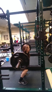 Freshman Olivia D. demonstrates her strength