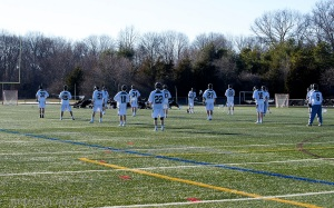 The Boys Lacrosse team takes advantage of the warm weather by practicing on the turf. Photo courtesy of Marilyn Quilty