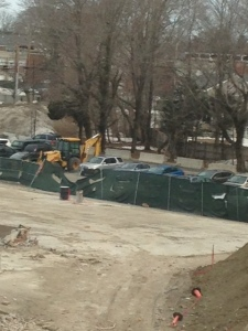 Mr. Brown's backhoe stands tall in its parking spot.